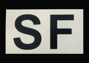 Aufnäher mit IR Buchstaben und Symbol